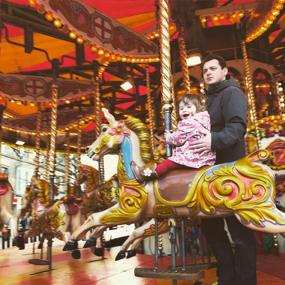Me and Alice enjoying the carousel